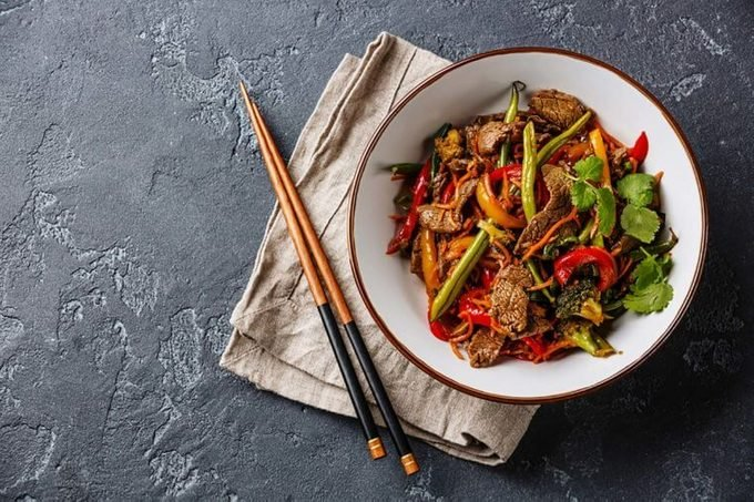 beef stir-fry with chopsticks