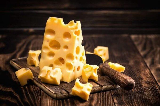 Swiss cheese on a cutting board