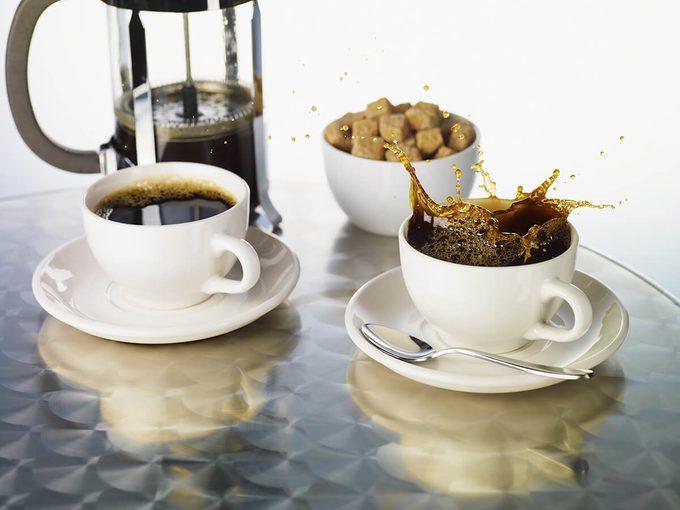 Coffee splashing from coffee cup