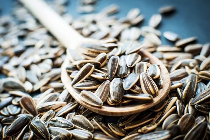 Hulled sunflower seeds in a wooden spoon