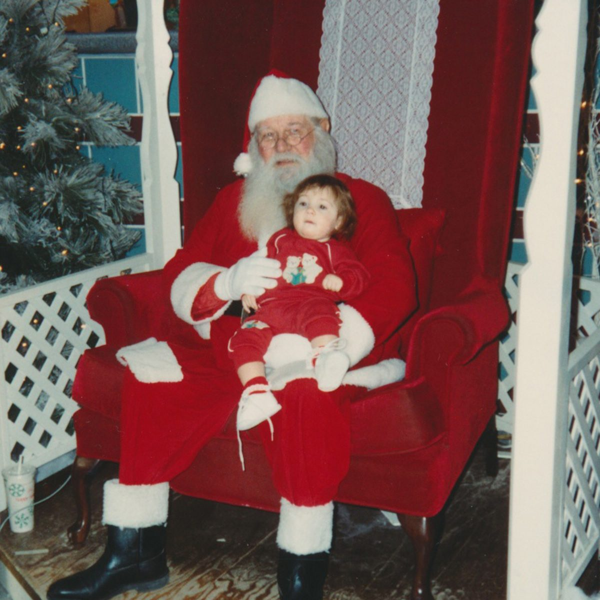Young child sitting on Santa's lap