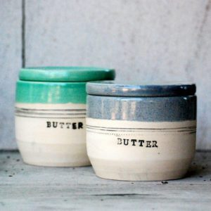 labeled butter containers side-by-side