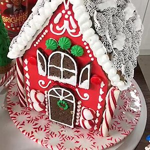 Decked out gingerbread house on a mint candy platter