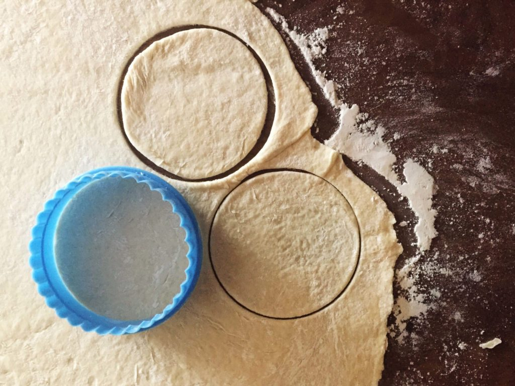Two circular cut-outs from the flattened dough