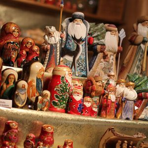 Rows of painted wooden figures on display