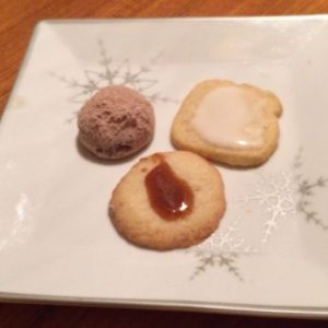 Poor photograph of three cookies on a plate