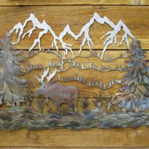 Close-up of metal on wood artwork of a moose in a river