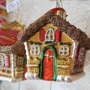 Close-up of two gingerbread house ornaments