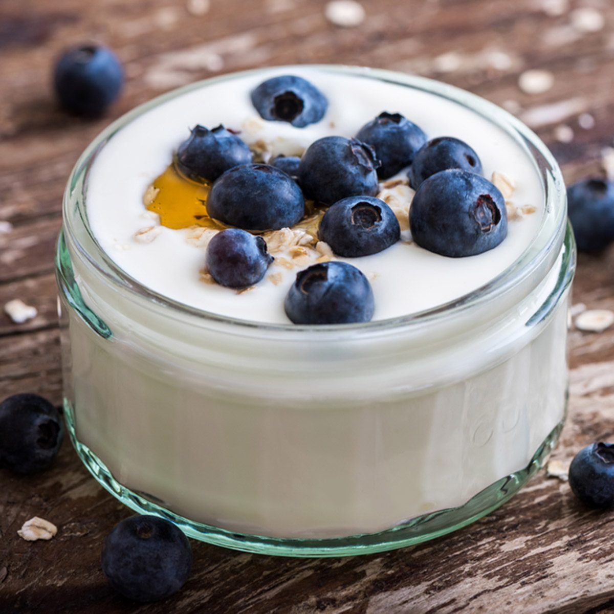 Serving of Yogurt with Whole Fresh Blueberries and Oatmeal on Old Rustic Wooden Table. Closeup Detail.; Shutterstock ID 298272557