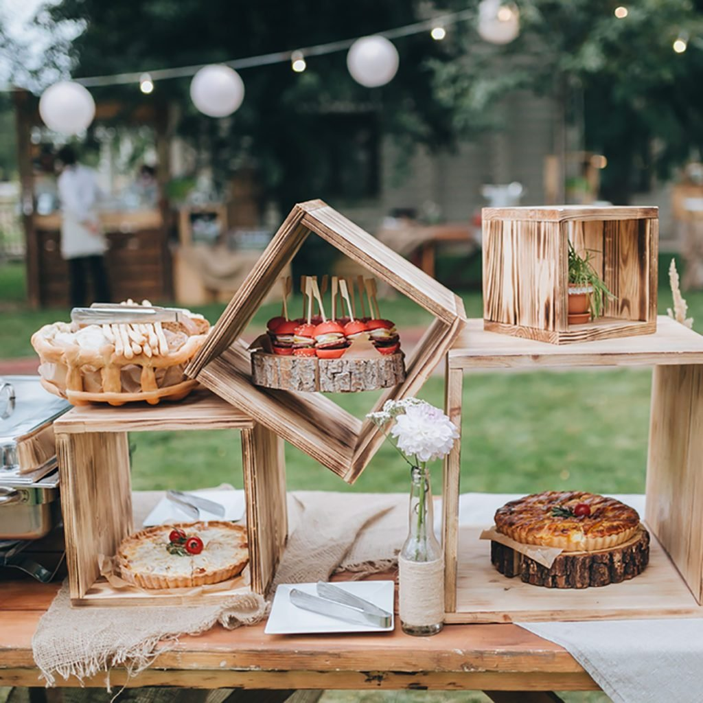 10 dessert table ideas to make your wedding reception unforgettable on decorated buffet table in wooden boxes are cakes and snacks shutterstock id 314779967 junglespirit Gallery