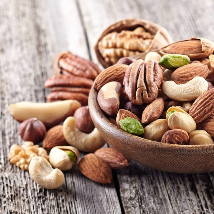 Nuts mix in a wooden plate; Shutterstock ID 355672364