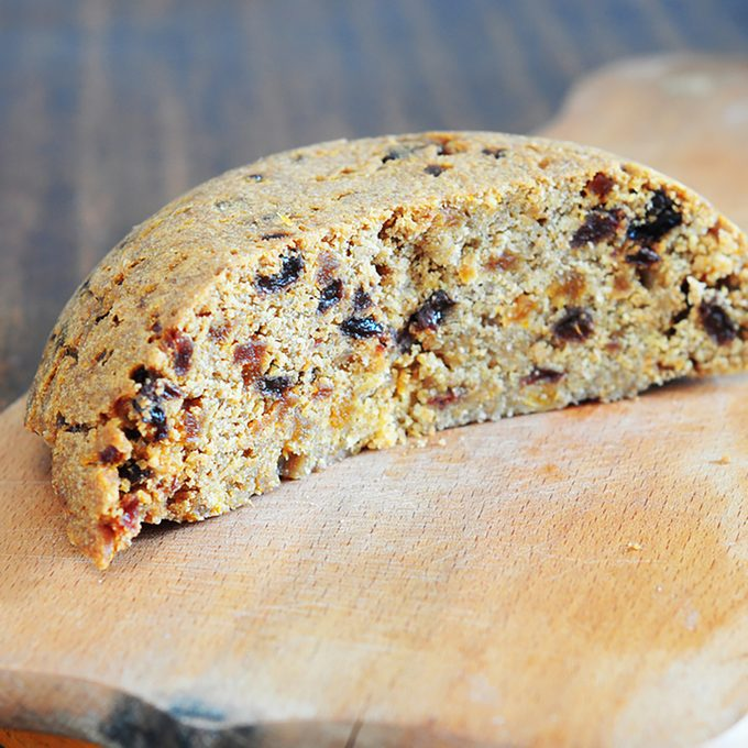 Spotted dick is a British pudding, made with suet and dried fruit (usually currants and  raisins) and often served with custard.