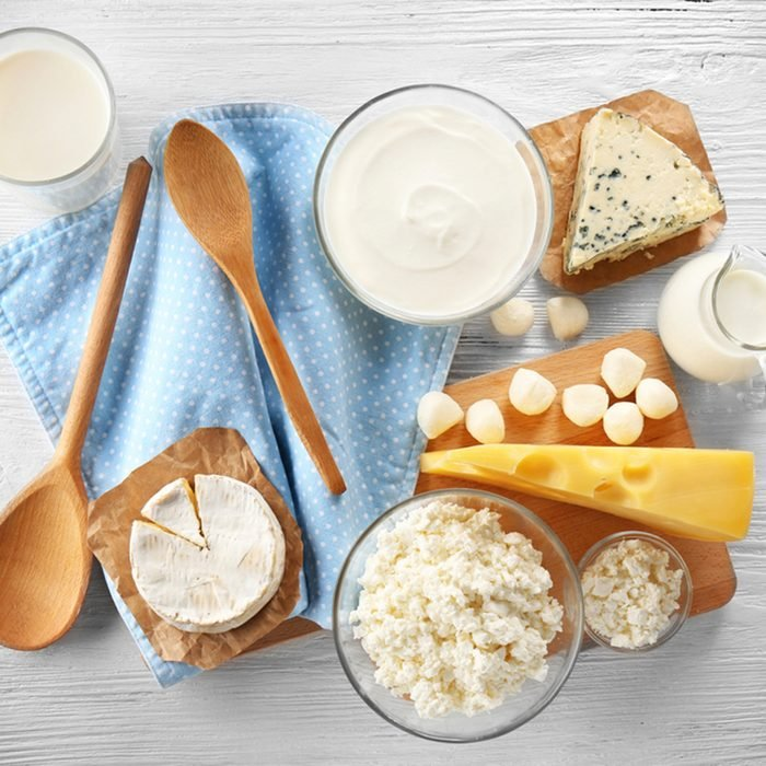 Different types of dairy products on wooden background; Shutterstock ID 573447319; Job (TFH, TOH, RD, BNB, CWM, CM): TOH