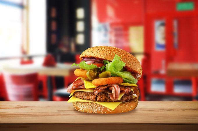 Double burger on wooden planks.