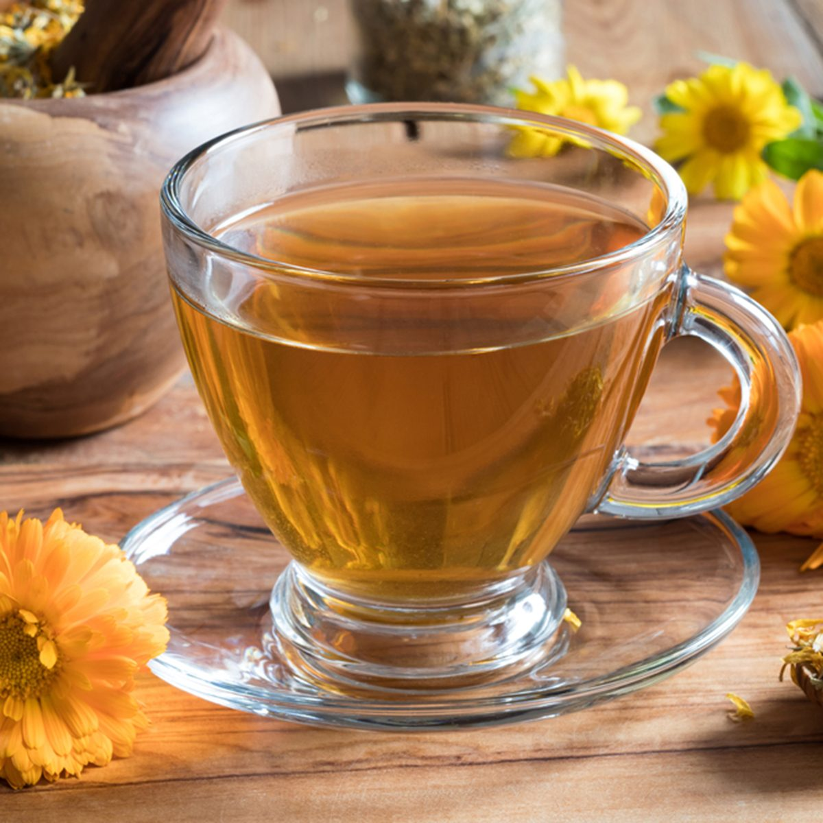Calendula tea with calendula flowers on a wooden table; Shutterstock ID 727124293; Job (TFH, TOH, RD, BNB, CWM, CM): TOH