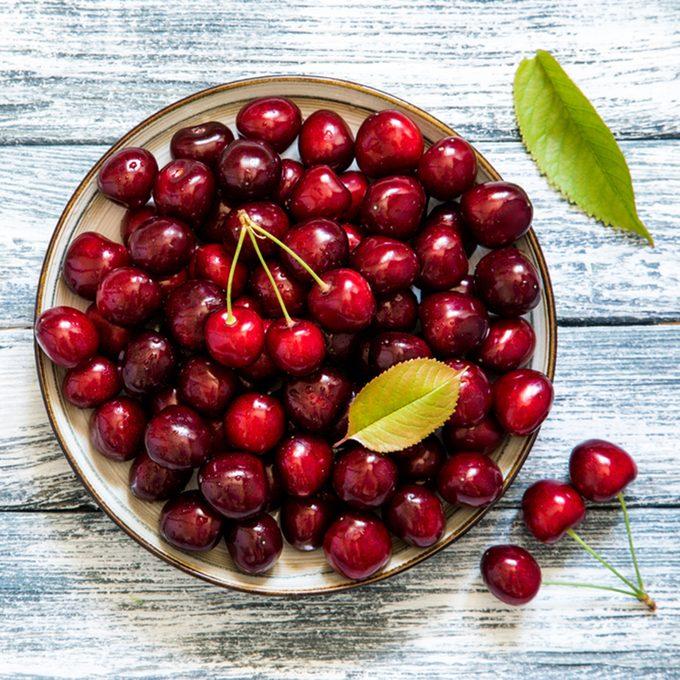 Fresh cherry on plate on wooden blue background. fresh ripe cherries. sweet cherries.; Shutterstock ID 663273784