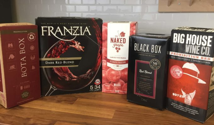 Boxed wines lined up on a countertop