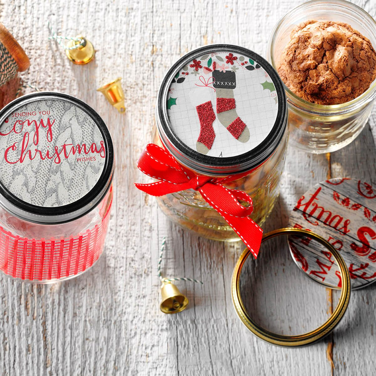 Mason jars with red ribbons and festive toppers