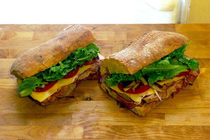 Cut in half sandwich on a cutting board