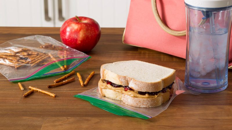 pretzels and pb&j sandwich sitting on zip-top bags