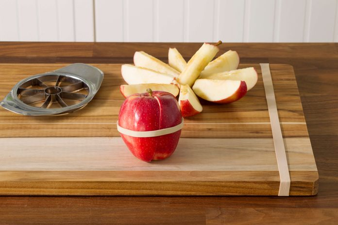 rubberbands, apples, cutting board, kitchen,