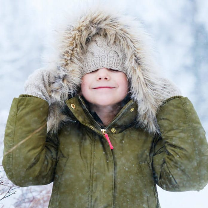 Adorable little girl outdoors on beautiful winter snow day; snow day