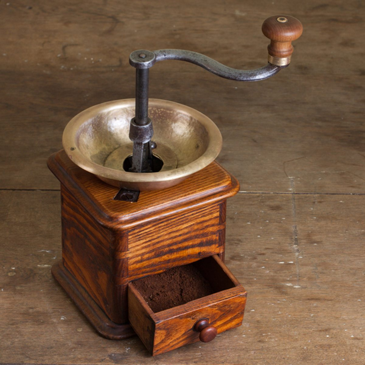 Vintage coffee grinder on old wooden table. Antique, XIX century; Shutterstock ID 103538423