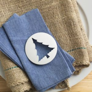 Plastic tree shaped biscuit cutter on blue napkin