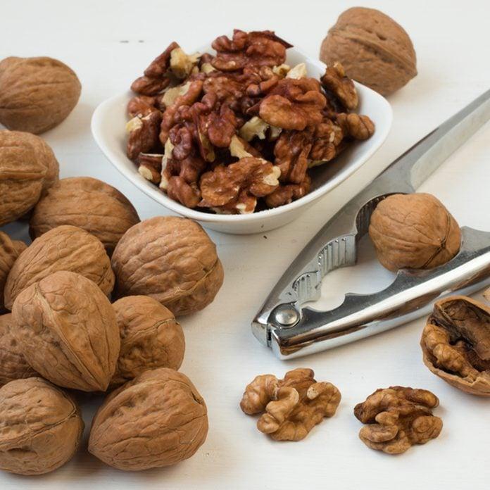 Walnuts.Whole walnuts,walnuts kernels and nutcracker.; Shutterstock ID 348316256