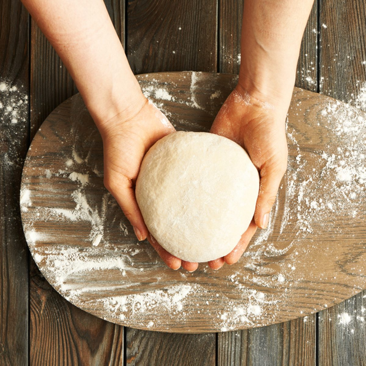Female hands kneading dough on wooden table; Shutterstock ID 400443688; Job (TFH, TOH, RD, BNB, CWM, CM): TOH