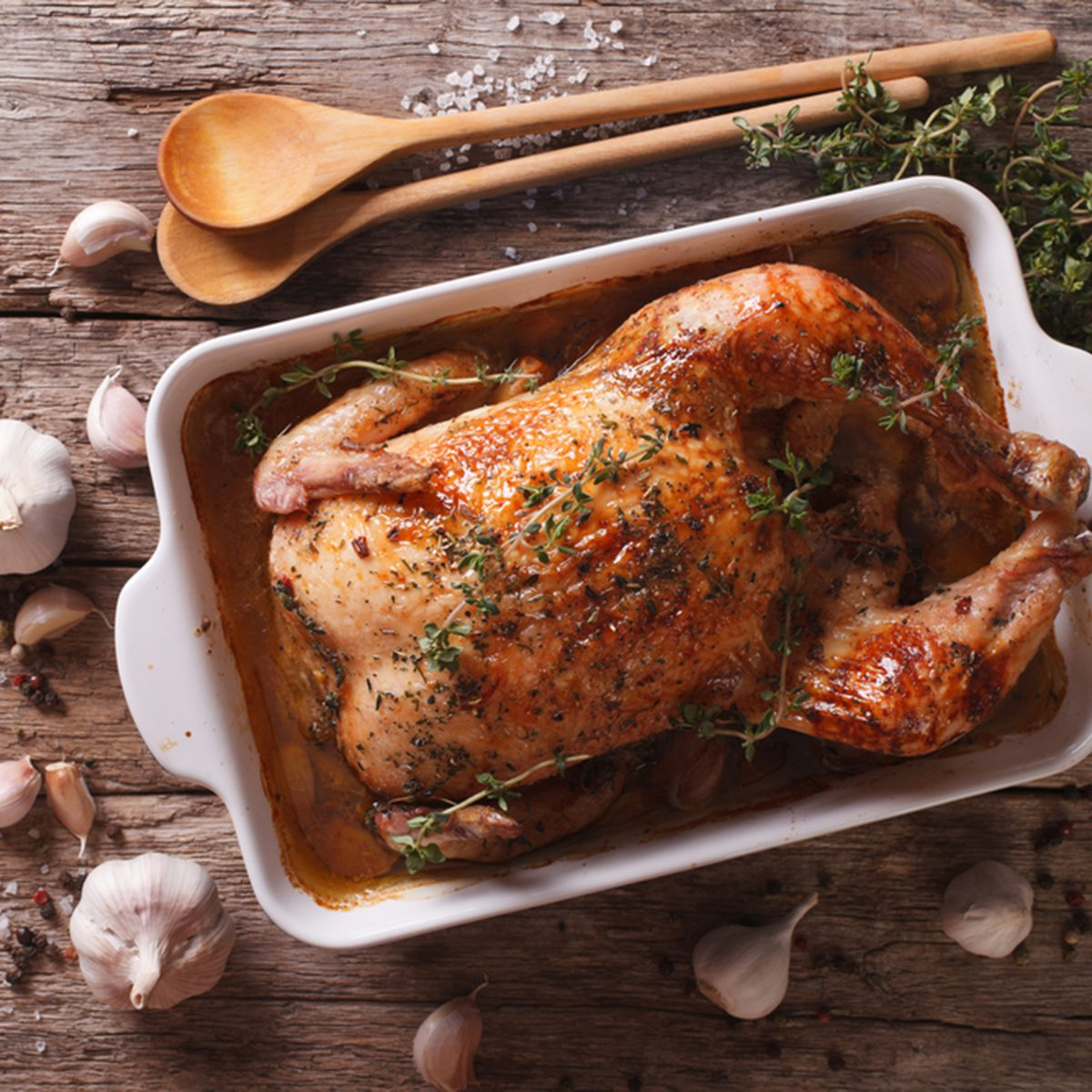 French Food: Chicken with forty cloves of garlic in the dish for baking and ingredients close-up on the table. horizontal view from above ; Shutterstock ID 412796311; Job (TFH, TOH, RD, BNB, CWM, CM): TOH
