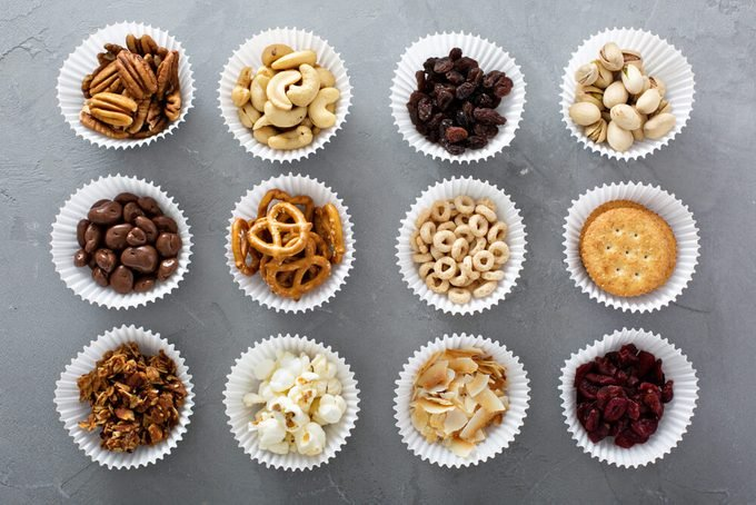 Variety of healthy snacks overhead shot laying on the table; cupcake liners