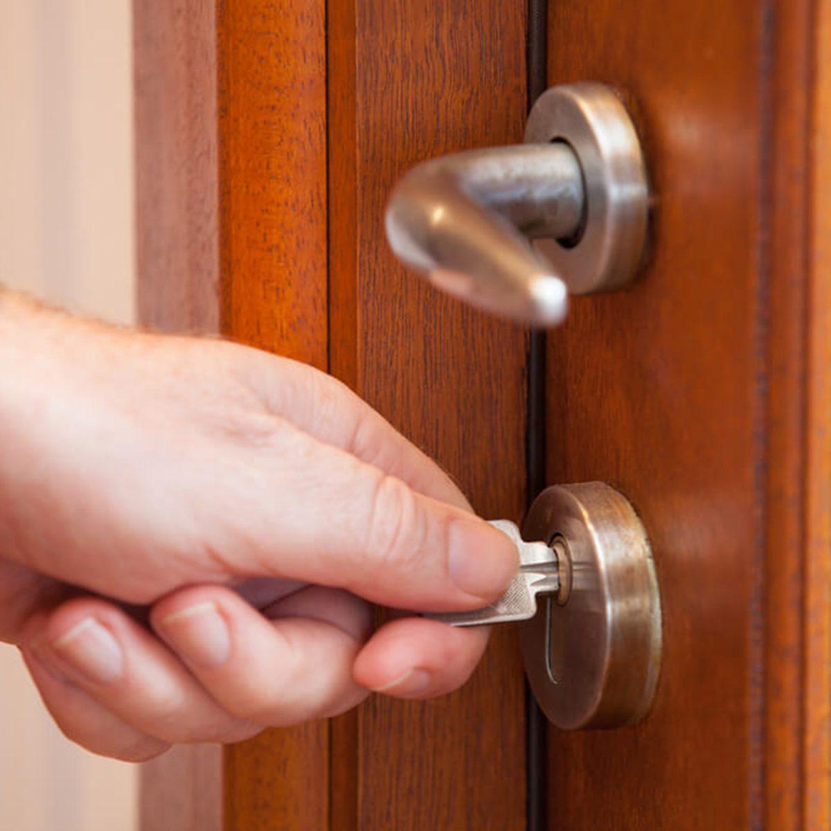 Putting key in lock