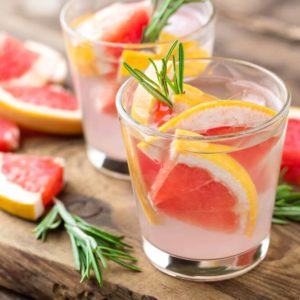 Refreshing drink, grapefruit and rosemary cocktail; infused vodka