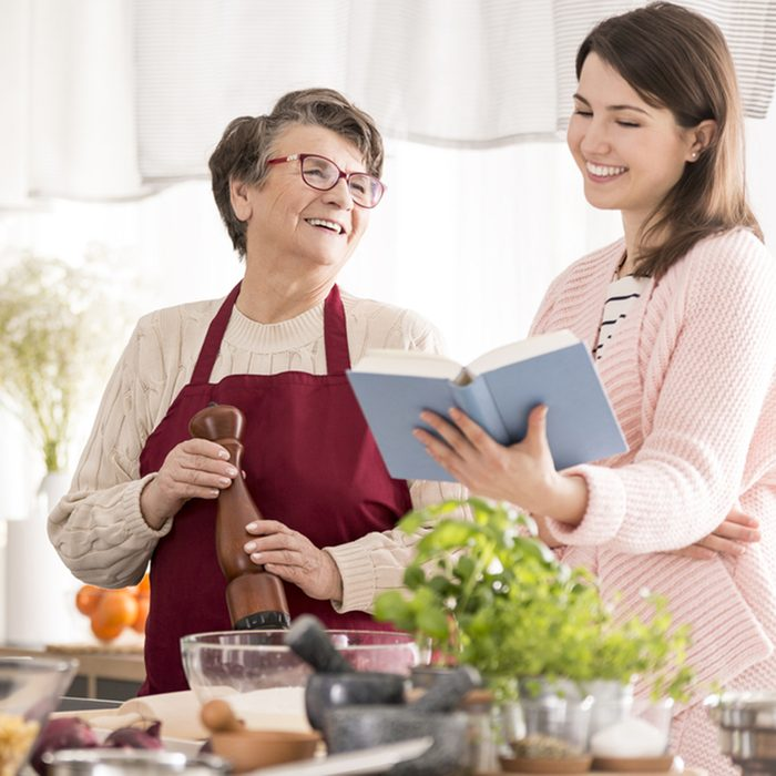 Happy grandma cooking with her granddaughter in modern kitchen; Shutterstock ID 640352344; Job (TFH, TOH, RD, BNB, CWM, CM): TOH