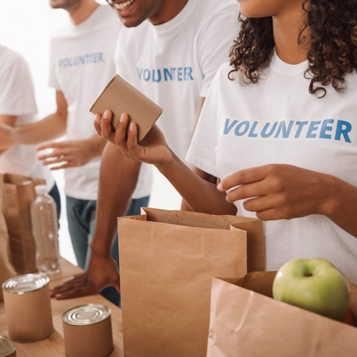 cropped shot of young volunteers group packing food and drinks for charity; Shutterstock ID 752375134; Job (TFH, TOH, RD, BNB, CWM, CM): TOH