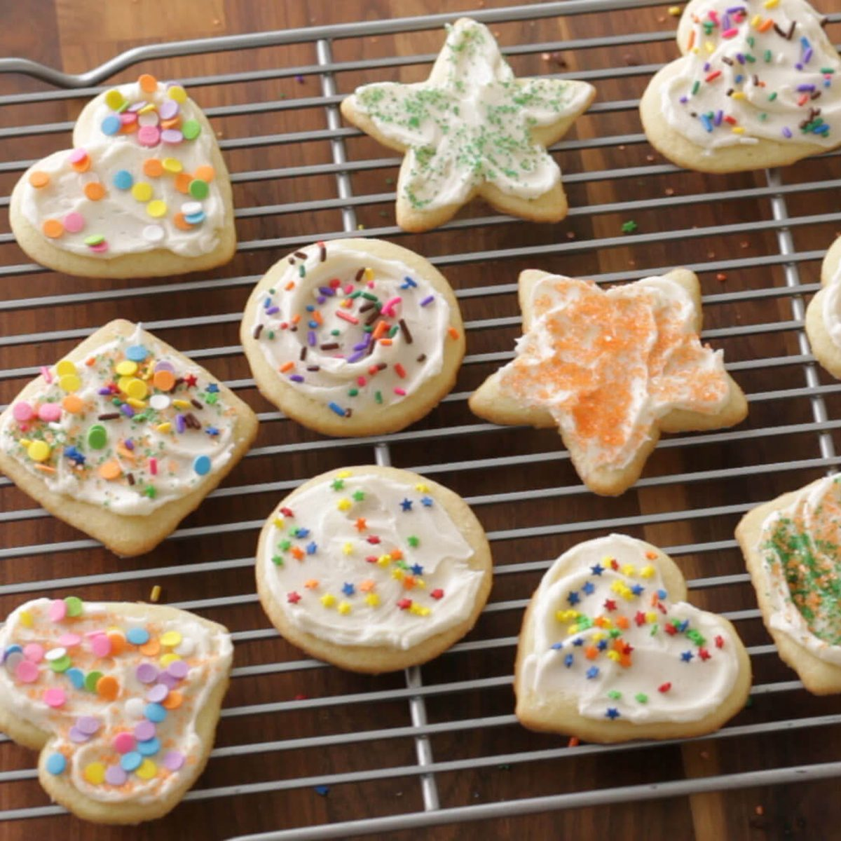 Wire rack filled with frosted sugar cookies