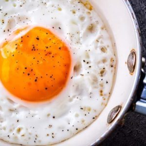 Egg cooking in a skillet