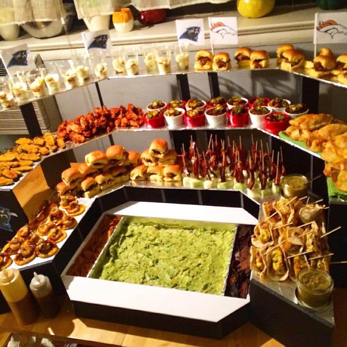 three-tiered Super Bowl snack stadium with guacamole field