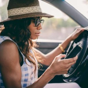 Woman on her phone in the car