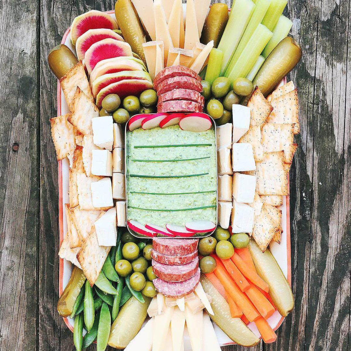 super bowl snack tray on wooden table