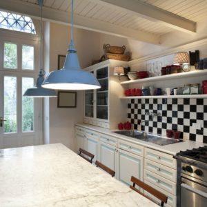 black and white tiled backsplash in a white kitchen