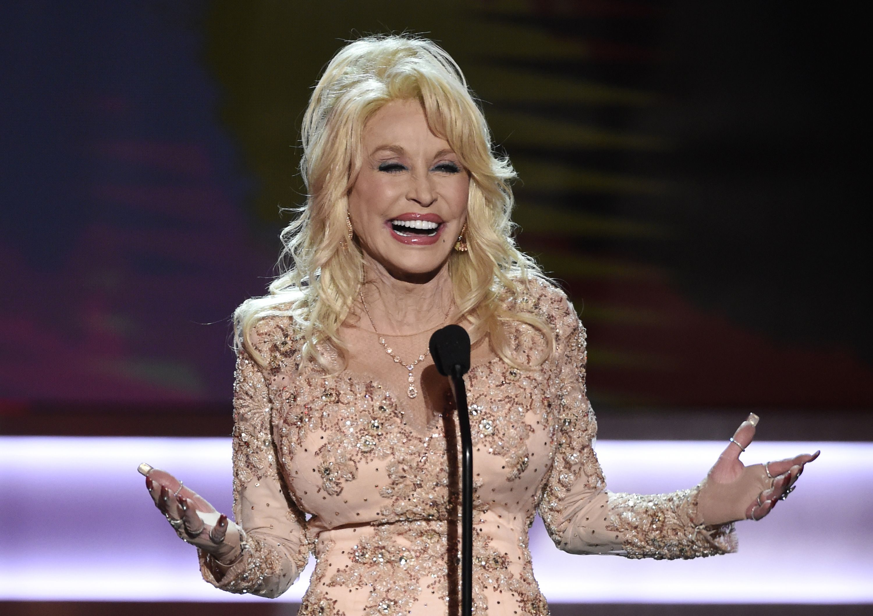 Dolly Parton presents the Lifetime Achievement Award at the 23rd annual Screen Actors Guild Awards at the Shrine Auditorium & Expo Hall in Los Angeles. Partonâ?™s My People Fund has issued monthly checks to hundreds of people who lost their homes in deadly wildfires that ravaged East Tennessee in 2016