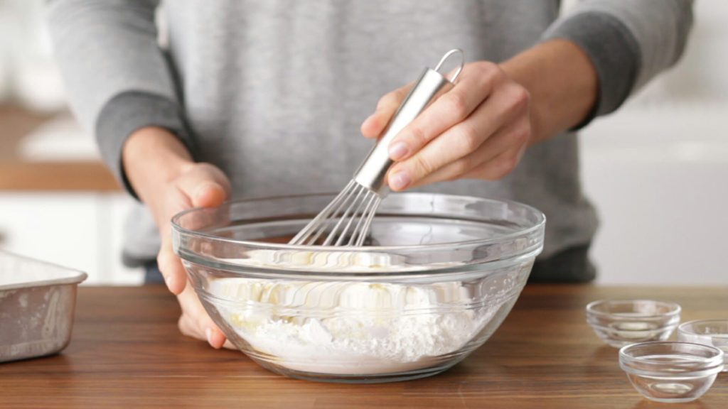 Person whisking ingredients in a bowl