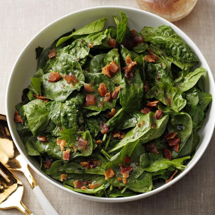 Hearty spinach salad with hot bacon dressing