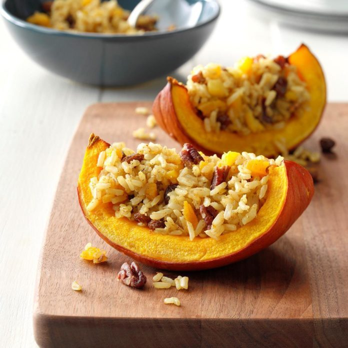 Scented rice in baked pumpkin on a cutting board
