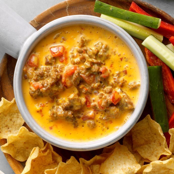 Slow-cooker cheese dip with tortilla chips and vegetables