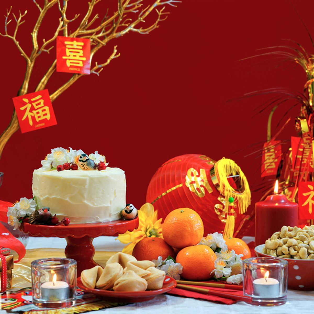 Chinese New Year Party Table In Red And Gold Theme With Food Traditional Decorations