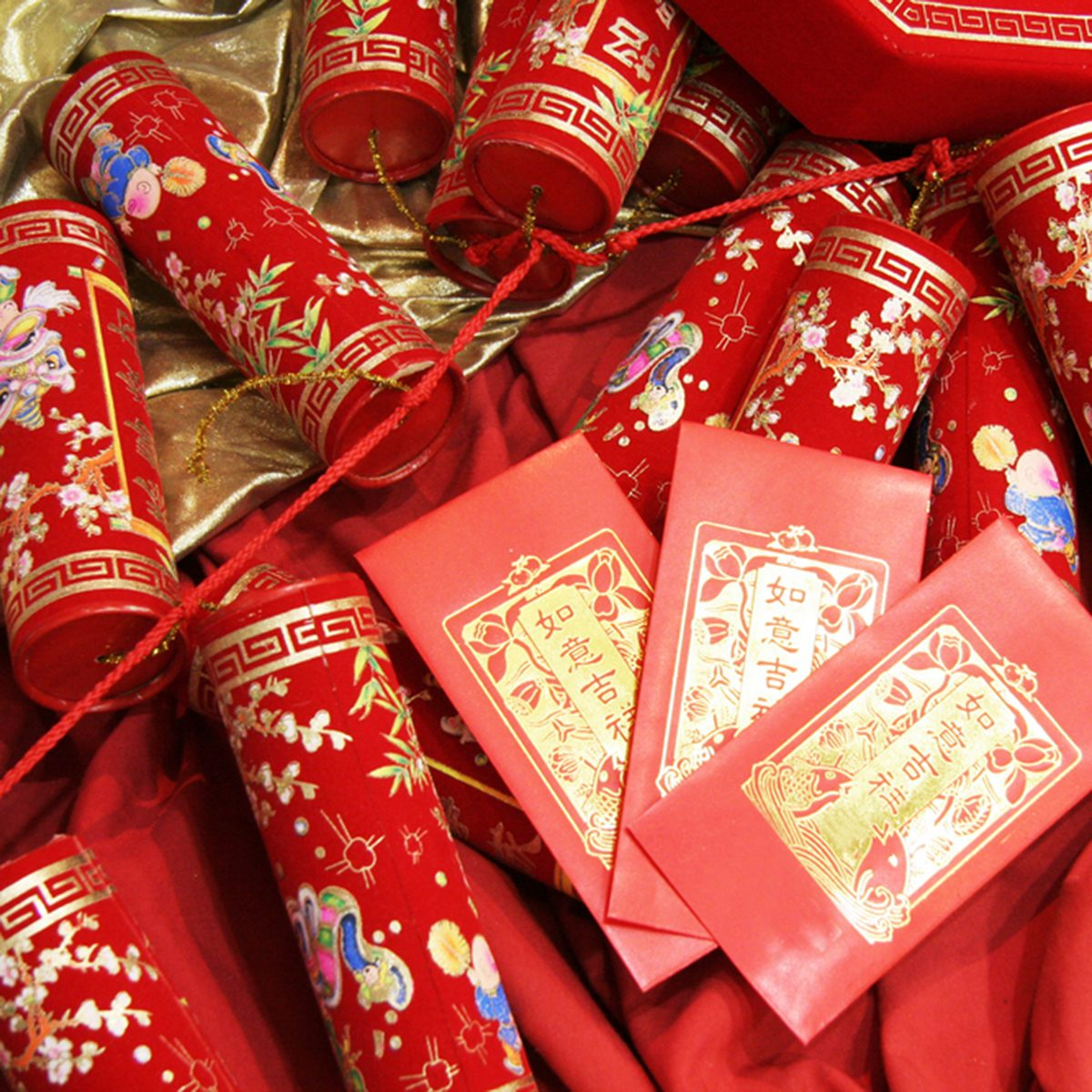 chinese celebration firecrackers and red envelope; Shutterstock ID 1025462
