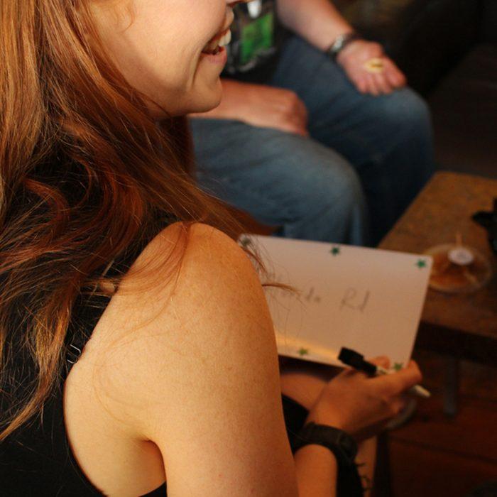 Girl playing quiz night; Shutterstock ID 1060742705; Job (TFH, TOH, RD, BNB, CWM, CM): Taste of Home